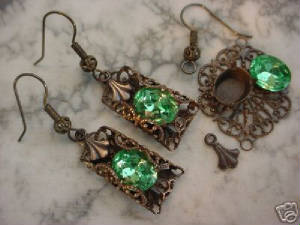 The Vintage 10x8 Czech Glass Peridot Rhinestone Is First Set In A Pronged Setting Before Being Filigree Wrapped With Our Hand Oxidized Small Lace Filigree